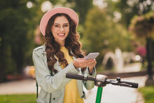 Photo Of Young Happy Smiling Cheerful Lovely Pretty Attractive Girl In Glasses And Hat Using Smartphone Outside In Park