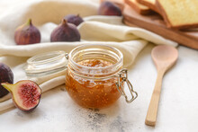 Glass Jar With Sweet Fig Jam On Grunge Background