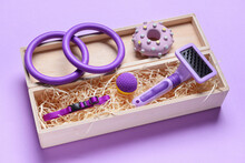 Box With Different Pet Accessories On Color Background
