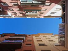 View From Below Of Blue Sky Between Buildings In Malaga