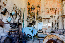 Old Agricultural Tools In The Cortevecchia Palace Of Grazzano Visconti, Piacenza, Italy