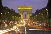 View Down The Champs Elysees To The Arc De Triomphe, Illuminated At Dusk, Paris, France