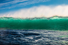 Turquoise Waves In Ocean. Breaking Wave With Light