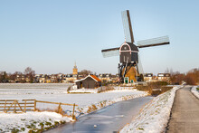 Windmill In The Winter, Near The Small Village Of Streefkerk, In Holland.
