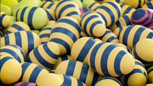 Multicolored, Easter Egg Background. Beautiful Yellow, Navy And Pink Eggs With Striped Patterns. 3D Render