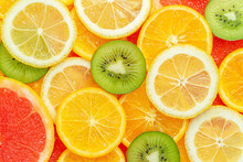 Colorful Summer Citrus Fruits Slices Background. Top View