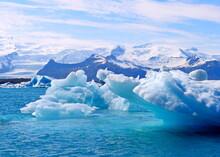 Iceberg In Polar Regions. Shiny Sparkling Icebergs And Blue Ice Floes In Wonderful Snowy Lagoon Jokulsarlon Iceland.