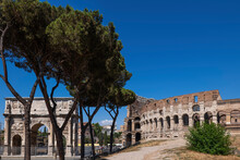 Italy, Rome, View Of The Colosseum And Arch Of Constantine