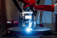 Close-up Of Automated Robot Welding Metal In Factory