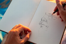 Man Doing Sketch In Book