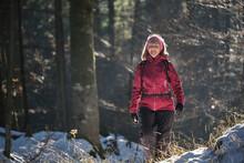 Woman Walking In Forest In Winter