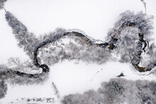 Drone View Of Meandering Stream In Winter
