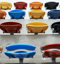 Colorful Plastic Seats Fold Up On Sports Stadium