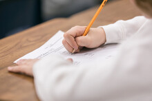Classroom: Anonymous Boy Student Taking Test