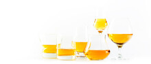 Hard Strong Alcoholic Drinks And Distillates In Glasses And Shot Glass In Assortment: Vodka, Cognac, Tequila, Scotch, Brandy And Whiskey, Grappa, Liqueur, Vermouth, Tincture, Rum. White Background