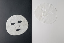 Two White Masks On A Black And White Background.