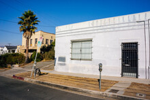 Warm Street Corner With Parking Meters In Urban Los Angeles California