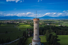 Tower Of San Martino Della Battaglia Italy. Cumulus Clouds In The Background Of Blue Sky, Lake Garda. Vineyard Plantation At High Altitude