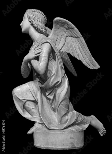 Angel statue isolated on black background Fotobehang
