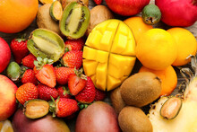 Different Tropical Fruits As Background