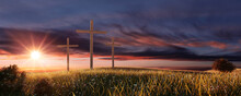Crucifixion And Resurrection. Three Crosses In Field By Sunset. Easter Or Resurrection Concept. He Is Risen. Happy Easter.