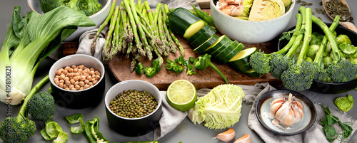 Canvas Set of various green raw healthy vegetables on wooden board