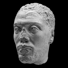 Antique Head Of The Ancient Man Priest Of Ancient Egyptian Isis With Cracks Sculpture. Face Statue Isolated On Black Background