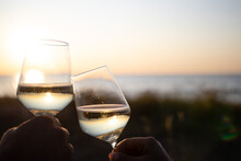Celebrating Life. Two Glasses Of Wine In The Sunset By Baltic Sea. Latvia