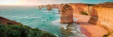 Twelve Apostles At The Great Ocean Road In Australia At Sunset - Panorama
