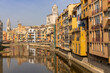the historic old city center of Girona in northern Spain with ist many colorful buildings along the banks of the Onyar River