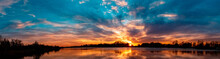High Resolution Stitched Panorama Of A Beautiful Autumn Or Indian Summer Sunset With Reflections Near Plattling, Isar, Bavaria, Germany