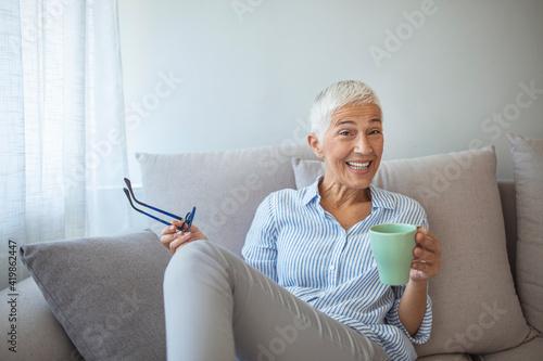 Obraz na plátně 50-year-old woman at home drinking tea