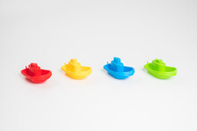 Plastic Toys. Multi-colored Boats On A White Background.