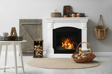 Cozy Living Room Interior With Firewood And White Fireplace
