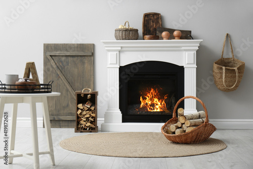 Cozy living room interior with firewood and white fireplace Wallpaper Mural