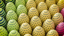 Multicolored, Easter Egg Background. Beautiful Yellow, Pink And Green Eggs With Polka Dot And Striped Patterns. 3D Render