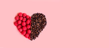 Red Raspberries In A Heart Shape On Pink Background. Minimal Composition.