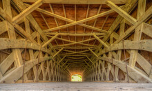 A Covered Bridge Built In The 1800s Located In Madison County, Iowa
