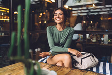 Cheerful Woman Relaxing In Cozy Cafe