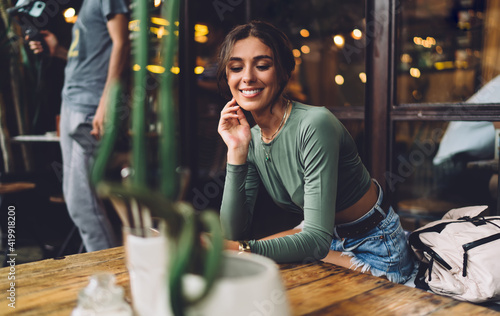 Pensive woman sitting at table in restaurant