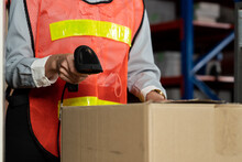 Warehouse Worker Using Barcode Scanner In Storehouse . Logistics , Supply Chain And Warehouse Business Concept .