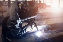 Cutting Of Steel Beam With Sparks Fly From Gas In Fabrication Factory.