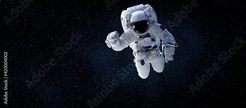 Obraz Astronaut spaceman do spacewalk while working for space station in outer space . Astronaut wear full spacesuit for space operation . Elements of this image furnished by NASA space astronaut photos. - fototapety do salonu