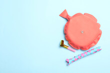 Whoopee Cushion, Party Blower And Chinese Finger Trap On Light Blue Background, Flat Lay. Space For Text