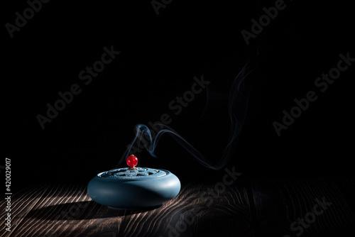 Obraz na plátne incense burner censer with smoke on black background.