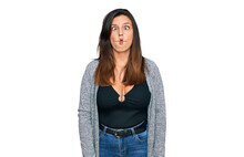Beautiful Hispanic Woman Wearing Casual Clothes Making Fish Face With Lips, Crazy And Comical Gesture. Funny Expression.