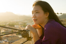 Romantic Lifestyle Portrait Of Young Happy And Beautiful Asian Korean Woman On Sunset At Love Padlocks Attached To City Railing Smiling Cheerful