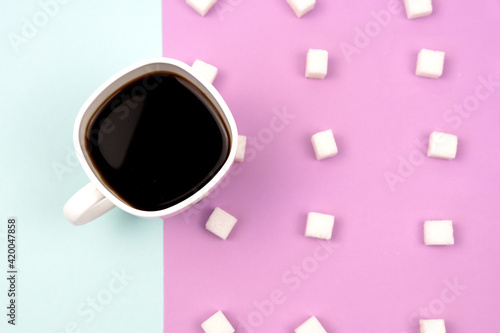 Fototapeta A glass of coffee with sugar on a double background. Unusual bright background. Space for your text. obraz na płótnie
