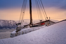 Snowy Fishing Boat In The Harbor In Lyngseidet Village