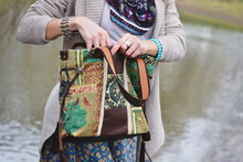Bohemian Purse, Canvas Boho Tote Bag. Blurred Background. A Woman On The Background Of The River Hides Something In Her Bag. Designer Unusual Bag.